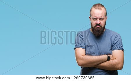 Young caucasian hipster man over isolated background skeptic and nervous, disapproving expression on face with crossed arms. Negative person. poster