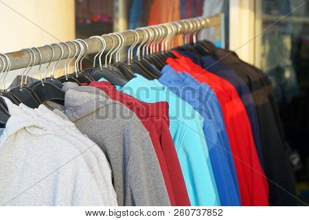 Clothes Hanger With Sports Warm Jacket. Fashionable Clothing On Hangers In Shop. Sports Warm Jacket