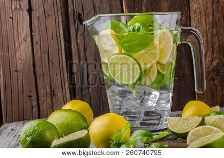 Lime Lemons Limonade, Fresh Herbs And Ice In