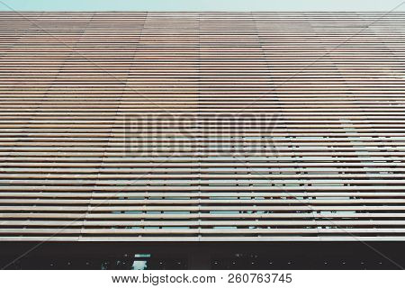 Facade Of The Modern Building Made Of Multiple Timber Battens In Parallel With The Stripe Of The Tea