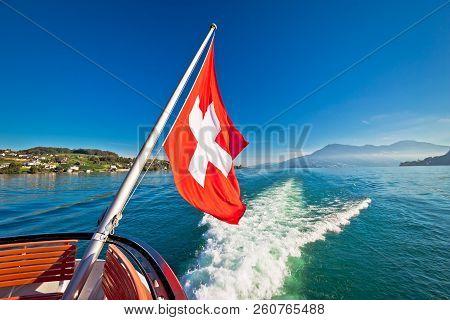 Switzerland Flag On Boat Flowing Luzern Lake, Scenic Landscape Of Switzerland