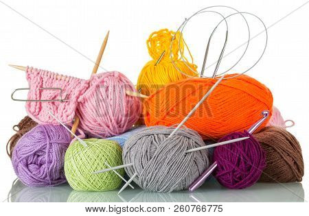 Lot Of Colorful Woolen Skeins Of Thread, Knitting Needles Isolated On White Background