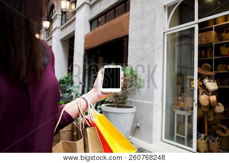 Woman Using Smart Phone For Shopping Online In Shopping Mall.