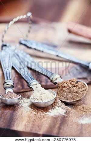 Pumpkin Pie Spice Ingredients With Cinnamon, Ginger And Nutmeg Over A Rustic Wooden Background. Extr