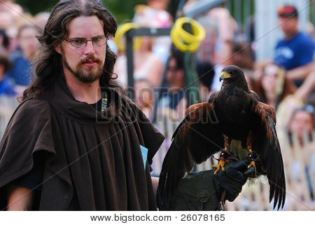 NEW YORK CITY - OCT 3: Man holding hawk in New York Medieval Festival. October 3, 2010 in Ft. Tryon park; Manhattan, New York City.