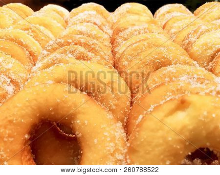 Closeup And Crop Lots Of Doughnut With Sugar On Shelf In The Bakery Shop Background And Wallpaper. D