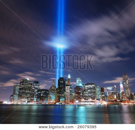 NEW YORK CITY, NY - SEP 11: Light beams are lit at the site in memory of World Trade Center destroyed on September 11. September 11, 2010 in Manhattan, New York City.