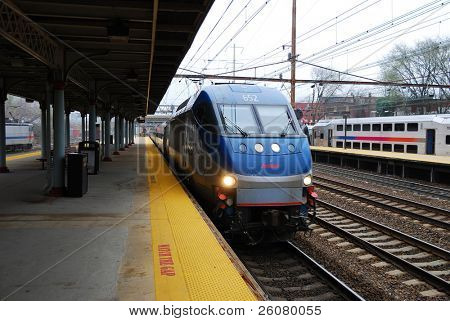TRENTON, NEW JERSEY - APRIL 3: Amtrak train is arriving at platform on April 3, 2011 in Trenton, New Jersey. Amtrak is owned by US federal government providing intercity passenger train service in US.