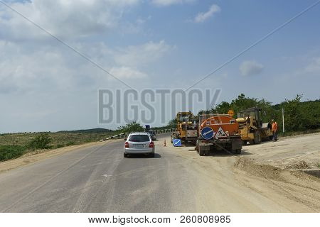 Repair Work On The Highway Between The Villages Of Guy-kodzor And Varvarovka. Sunny Summer Day