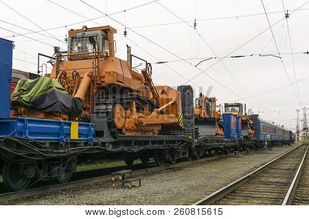Heavy Orange Bulldozers Stands On The Flatcar Of The Train For Accident Recovery Work