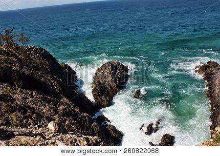 Looking down the sea cliffs at Devil's kitchen, Sunshine Coast, QLD, Australia