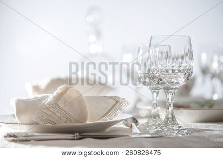 Fine Dinning: Floral Pattern White China Dinner Set Arranged On A Table With Vintage Tablecloth And