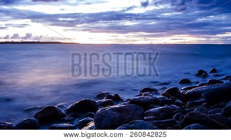Beautiful Sunset, Rainclouds On The Horizon. Evening On Shore Of The Baltic Sea  With Waves, Tallinn