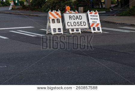 Road Closed Signs And Barricades Placed On A Crosswalk At An Intersection