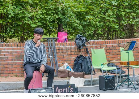 Daejeon, South Korea; September 20, 2018:  Unidentified Korean Male Performer Singing A Song On The