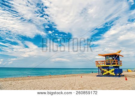South Beach, Miami, Florida, Lifeguard House In A Colorful Art Deco Style On Cloudy Blue Sky And Atl