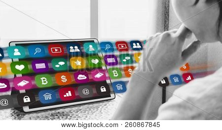Online Media And Application Technology On Digital Tablet. A Man Using Online Media Application On D