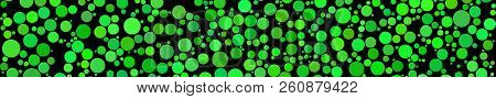 Abstract Horizontal Banner Of Circles Of Different Sizes In Shades Of Green Colors On Black Backgrou