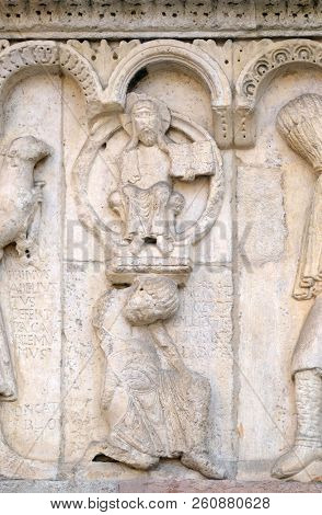 MODENA, ITALY - JUNE 04: Plate with stories from Genesis: Story about Abel and Cain, God the Father, relief by Wiligelmo, Modena Cathedral, Italy on June 04, 2017.