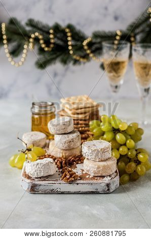 Christmas Cheese Platter, Variety Of French Cheeses, Green Grapes, Walnuts, Honey And Crackers, Copy