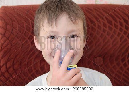 sick boy in nebulizer mask making inhalation, respiratory procedure by pneumonia or cough for child,  inhaler, compressor nebulizer,  nebules machine for health care. Kid catch cold poster