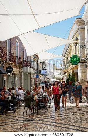 Faro, Portugal - June 12, 2017 - View Along The R De Santo Antonio Lined With Restaurants And Shops