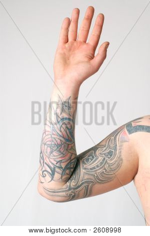 Man's arm covered with tattoos