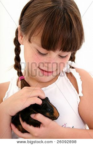 Eight year old girl holding her pet guinea pig.