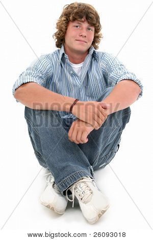 Attractive Sixteen Year Old Teen Boy in casual over white background.  Light brown curly hair and hazel eyes.