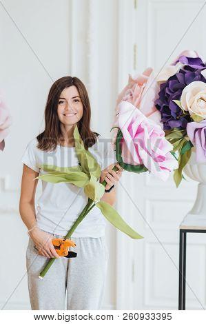 Florist At Work: Beautiful Woman Makes Bouquet, Works At Flower Shop, Arranges Decorations, Dressed