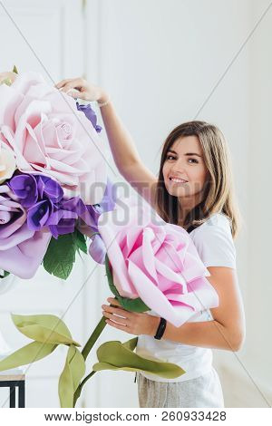 Floristry, Gardening And Designing Concept. Happy Smiling Young Female Florist Has Charming Friendly