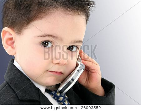 Little man discussing important business on the cell phone. Shot in studio.