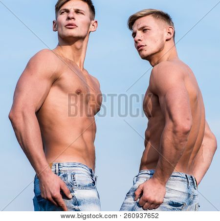 Strong muscles emphasize masculinity sexuality. Men muscular athlete bodybuilder show muscles. Sexy torso attractive macho. Bodybuilder shape. Men muscular chest naked torso stand sky background poster