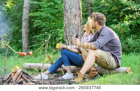 Couple Relaxing Sit On Log Having Snacks. Hike Picnic Date. Family Enjoy Romantic Weekend In Nature.