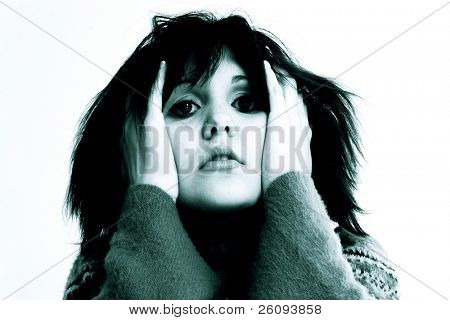 Teen girl with troubled or scared expression.