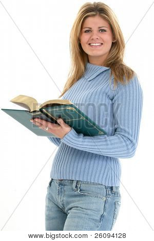Beautiful teen girl reading book over white background.  Blonde hair, hazel eyes and great smile.