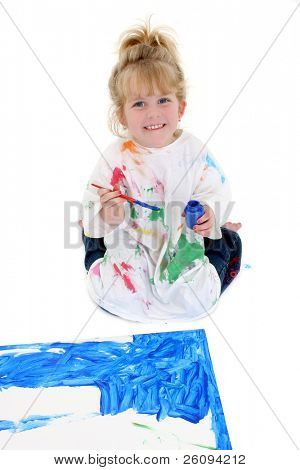 Adorable Young Girl Painting Poster Board on Floor. Shot in studio over white.