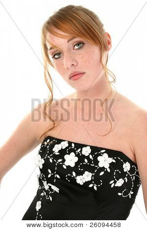 Beautiful teen girl dressed for the school sweatheart dance. Shot in studio over white
