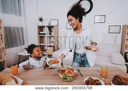 Mother And Girl Dring Juice Happy Moment Together. Mulatto And Mother Time Together. Love Mother And
