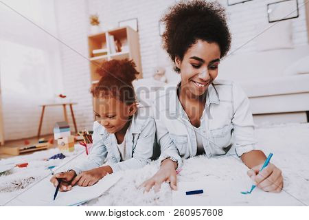 Child With Mother Draw With Pen. Studio For Draw. Exercise For Young Girl. Beautiful Girl And Mother