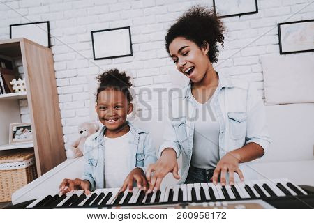 Mulatto And Young Girl Play Together. Smile And Happy Girl. Positive Time. Happiness Girl. Hobbies W