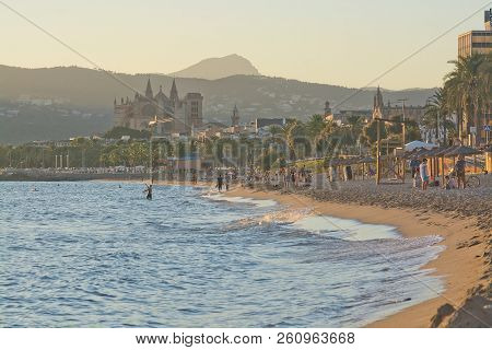 Mallorca, Spain - September 28, 2018: La Seu Cathedral And City Beach With People On A Sunny Afterno
