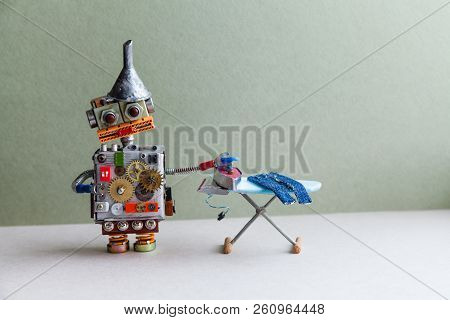 Domestic Robot Ironing Jeanes, Green Gray Background. Robotic Automation Housework Service Concept.