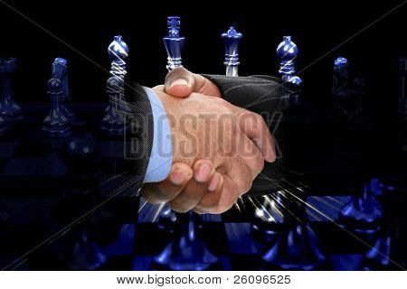 Two men shaking hands over chess board.