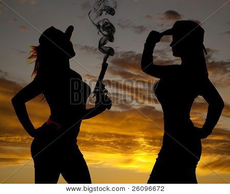 Two Women Silhouette One Gun Smoke