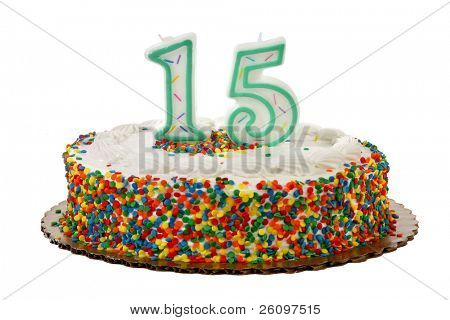 White iced sprinkle covered anniversary or birthday cake with number 15 candles on it.