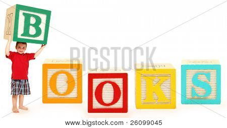 Colorful alphabet blocks spelling the word BOOKS with adorable three year old boy holding the letter B.