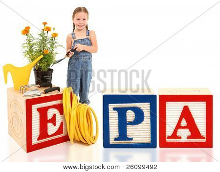 Attractive 5 year old american girl with potted marigold plant and garden tools. Word EPA in large alphabet blocks.