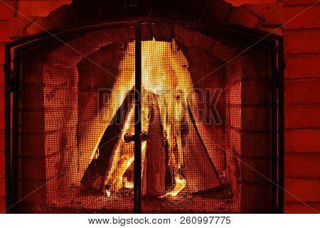 Burning Fireplace. Burning Wood In Brick Fireplace. Fireplace With A Blazing Fire. Fire In A Firepla