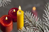 a christmas still life with candle and christmas tree poster